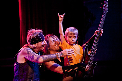 Yes, this is the shot making the rounds everywhere!!!  The playful interaction between Jack, Dario, and a young wanna-be rockstar on stage. The little rocker is actually Robby Lochner's nephew (Tyler) from Tucson, AZ. Robby is one of two guitarist in the current line-up of Jack Russell's Great White.