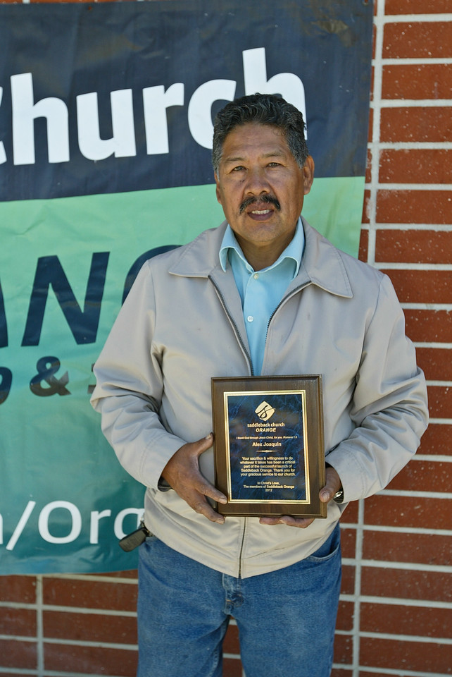 Alex Joaquin holding the plaque that was awarded to him. Mr. Joaquin was one of the two janitors that faithfully served our church since December 24, 2010 by keeping the campus clean.