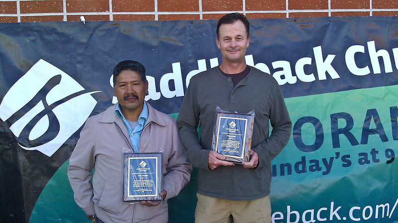 Alex Joaquin and Mark Smith with the plaques presented to them for keeping the campus of Cerro Villa Middle school clean for our church services every Sunday since December 24, 2010.