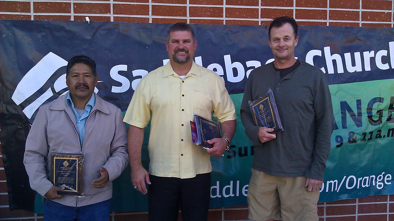 Alex Joaquin, Principal Ken Miller, and Mark Smith after receiving their plaques at Cerro Villa Middle school.
