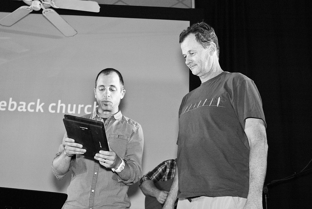Pastor Jeremiah Goley presenting Mark Smith one of the two janitors that provided Saddleback Orange with a clean environment every Sunday since December 24, 2010.