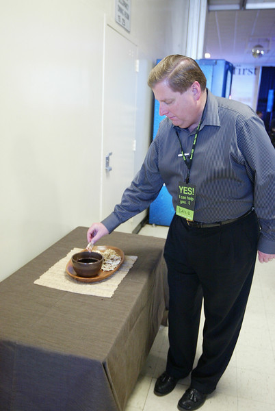 David partaking in the Communion at our last service at Cerro Villa Middle school on April 1, 2012.