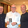 Dave Moore (centre) receives his Open Class winner's trophy from Tim Emery (left) and Randy Stagno Navarra