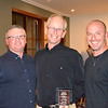 "Peter ""Princy"" Phillips (centre) receives his Clubman winner's trophy from Tim Emery (left) and Randy Stagno Navarra"