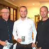 Jeremy Fredersdorff (centre) receives his Standard NB trophy (second place) from Tim Emery (left) and Randy Stagno Navarra