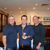 Daniel White (centre) receives his Modified Class third-place trophy from Tim Emery (left) and Randy Stagno Navarra
