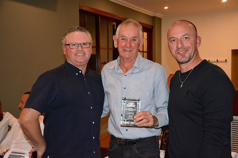 Leon Bogers (centre) receives his Clubman second-place trophy from Tim Emery (left) and Randy Stagno Navarra