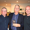 Alan Conrad (centre) receives his Standard NC winner's trophy from Tim Emery (left) and Randy Stagno Navarra