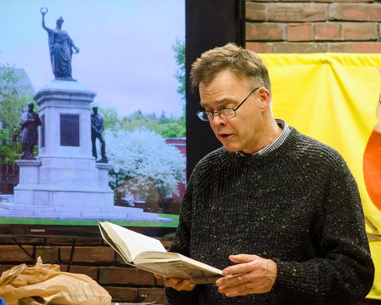 Jeff Van Amburgh reads Civil War-era letters during a presentation at the Fitchburg Public Library on Thursday evening. SENTINEL & ENTERPRISE / Ashley Green
