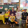 Gary Withington, from the DPW, joins children during the DPW Day art show at the Fitchburg Public Library on Tuesday afternoon. Pictured with Withington are Jaxden Ouellette, 4 (front), Anastasia Awad, 4, Elizabeth Fey, 7, Olivia Chura, 11, Laura Andrews, 8, and Joshua Ouellette, 7. SENTINEL & ENTERPRISE / Ashley Green