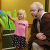 Cora German, 6, of Leominster visited Leominster Public Library on Friday morning to see Jedi Jim's, aka Jim Manning, show based on the Movie franchise Star Wars. She got to help him out with some of his magic tricks during the show. SENTINEL & ENTERPRISE/JOHN LOVE
