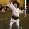 Harry Lafosse, 4, from Gardner dressed up as Luke Skywalker when he visited Leominster Public Library on Friday miorning to see Jedi Jim's, aka Jim Manning, show based on the Movie franchise Star Wars. Here Lafosse does a Jedi mind push as he battles Jedi Jim during his show. SENTINEL & ENTERPRISE/JOHN LOVE
