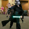 Nico Vicioso, 8, of Leominster dressed up as Kylo Ren when he visited Leominster Public Library on Friday morning to see Jedi Jim's, aka Jim Manning, show based on the Movie franchise Star Wars. Here  Vicioso does a Jedi mind push as he battles Jedi Jim during his show. SENTINEL & ENTERPRISE/JOHN LOVE