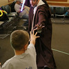 Jedi Jim's, aka Jim Manning, visted the Leominster Library on Friday to bring the Movie franchise Star Wars to the kids. Jedi Jim battles one of the kids during his show at the libray. SENTINEL & ENTERPRISE/JOHN LOVE