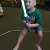 Nico Vicioso, 8, of Leominster dressed as Princess Leia when she visited Leominster Public Library on Friday morning to see Jedi Jim's, aka Jim Manning, show based on the Movie franchise Star Wars. She got to battles Jedi Jim during his show. SENTINEL & ENTERPRISE/JOHN LOVE