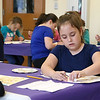 "Kids try and paint recreations of Gustav Klimts' painting ""The Tree of Life"" at the Leominster Public Library on Tuesday morning. Working hard on her painting is Madison Fluet, 8, of Leominster. SENTINEL & ENTERPRISE/JOHN LOVE"
