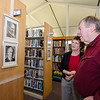 Kim and Fred Cochrane take a look at the mayoral portraits on display at the Fitchburg Public Library on Thursday afternoon. SENTINEL & ENTERPRISE / Ashley Green
