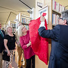 Joanne DiNatale and Mayor Stephen DiNatale unveil his portrait at the Fitchburg Public Library on Thursday afternoon during a gallery opening of Fitchburg's mayoral portraits. By the DiNatales side are former mayors Bill Flynn, Mary Whitney and Dan Mylott. SENTINEL & ENTERPRISE / Ashley Green