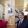 Joanne DiNatale and Mayor Stephen DiNatale unveil his portrait at the Fitchburg Public Library on Thursday afternoon during a gallery opening of Fitchburg's mayoral portraits. SENTINEL & ENTERPRISE / Ashley Green