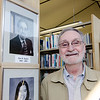 Former Mayor Dan Mylott stands by his portrait at the Fitchburg Public Library on Thursday afternoon during a gallery opening of Fitchburg's mayoral portraits. SENTINEL & ENTERPRISE / Ashley Green