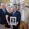 Former mayors Bill Flynn, Mary Whitney and Dan Mylott join Stephen DiNatale during the unveiling of his mayoral portrait at the Fitchburg Public Library on Thursday afternoon. SENTINEL & ENTERPRISE / Ashley Green