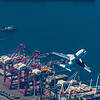 Space Shuttle Endeavour over the Port of Long Beach.