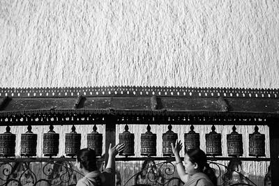 Devotees spinning prayer wheels at Monkey Temple (Swambunath).