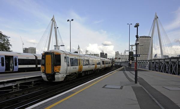 Charing Cross station, Sat 26 April 2014 1 - 1755.  SouthEastern Electrostar 375710 departs plaform 4.
