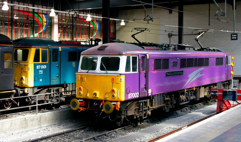 87001 Stephenson & 87002 The AC Locomotive Group, Euston, 13 May 2005 - 1529.  By 2012 only three class 87s remained in Britain - 87001, 87002 & 87035.  Eleven had been scrapped  and 21 were in Bulgaria,