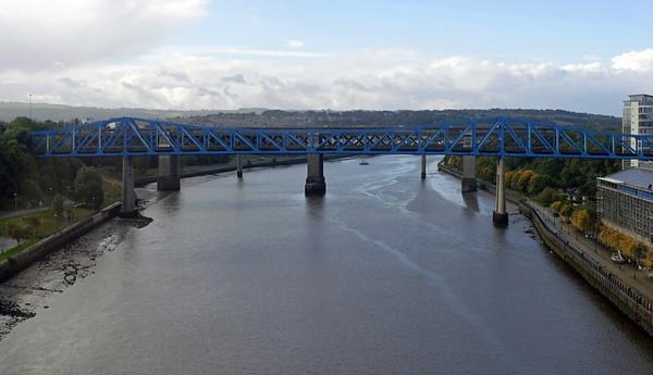 Tyne railway bridges, Newcastle, Wed 9 October 2013 - 1153.  Looking west (upstream) from inside 142020 on the High Level bridge to the Queen Elizabeth II Metro bridge, with the King Edward VII bridge beyond.