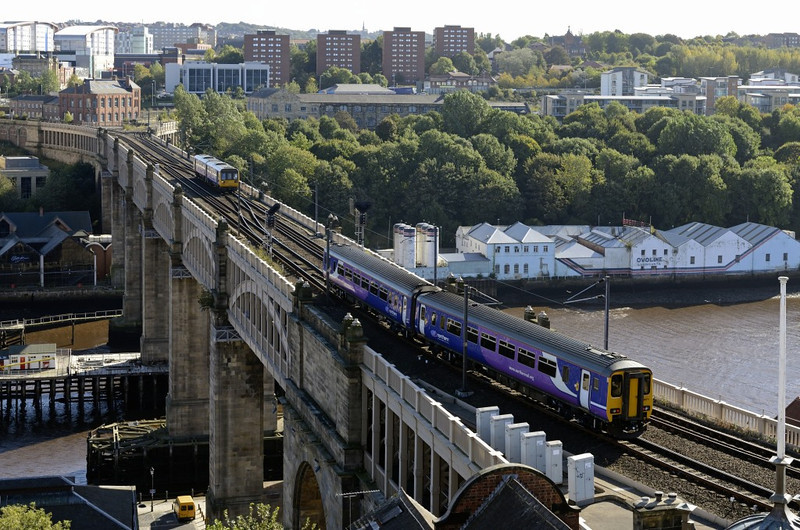 142xxx & 156471, High Level Bridge, Newcastle, Wed 9 October 2013 - 1357.  Northern's 1216 Nunthorpe - Hexham  stands at the signal as the Pacer approaches with Northern's 1223 Carlisle - Newcastle.  The Sprinter will then take the track used by the Pacer to reach the Metrocentre.
