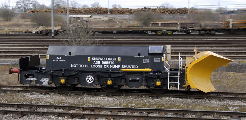 Snowplough ADB 965579, Kingmoor yard, Carlisle, Thurs 1 April 2010 - 1046.    Beilhack Type PB600 plough mounted on a class 40 bogie.  Sister ADB 965588 was also at Kingmoor.