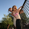 Birds on a wire--Megan and Carly.  Watching the pros at the Beach Skatepark