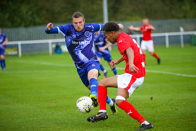 Hanley Towns Josh Green attempts to steal the ball from Brackley Town defender Twariq Yusuf