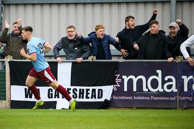 The Gateshead fans celebrate as Cedwyn Scott makes in 3-2