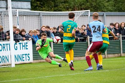 Runcorn Linnets keeper Joe Young saves a first half chance