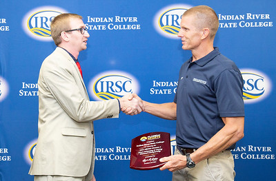 Florida Sports Foundation awards presented to IRSC's swimming and diving coaches on behalf of the men's and women's swimming and diving teams.  photographed on Wednesday, August 8, 2018, on the main campus in Fort Pierce. Jason M. Hendrix (left) Director of Communications for the Florida Sports Foundation and IRSC swim coach, Sion Brinn.