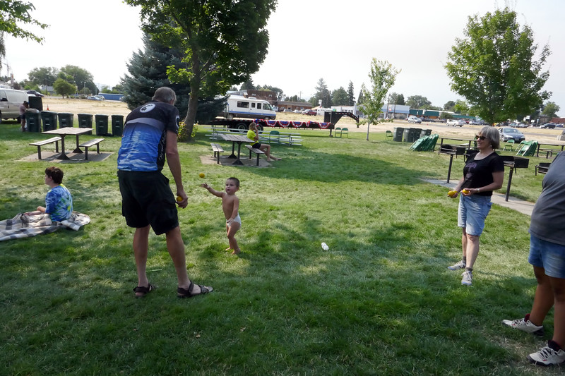 Bud teaching juggling to a young student