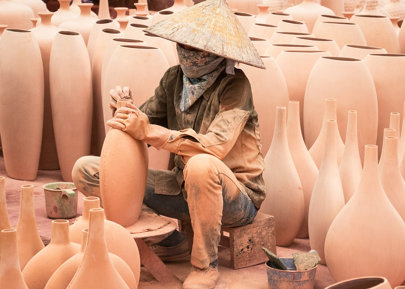 This workshop for tourist-destined pottery in Ha Long, northern Vietnam, offered interesting composition opportunities. I chose a low angle so that the entire background is pottery patterns. [PLAN PRODUCTIVE WANDERING section, third paragraph, page 38]