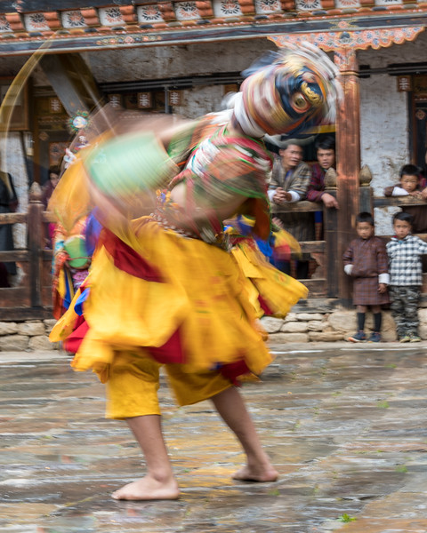 "Nimalung Tshechu, Bumthang, Bhutan.  A Drummer from Dramtse dancer, with captivated villagers looking on. This dance was declared a ""Masterpiece of the World Intangible Heritage"" by UNESCO in 2005."