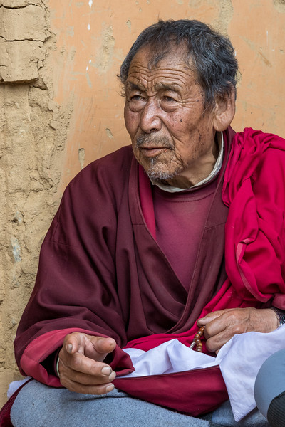 Gantey Goemba, Phobjikha Valley, Bhutan. A festival attendee joins in a discussion with others during lunch at the temple.