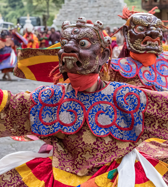 Kurjey Tshechu, Bumthang, Bhutan. In the Dance of the Terrifying Deities (Tungam), dancers dress in brocade and wear masks of wrathful dieties.