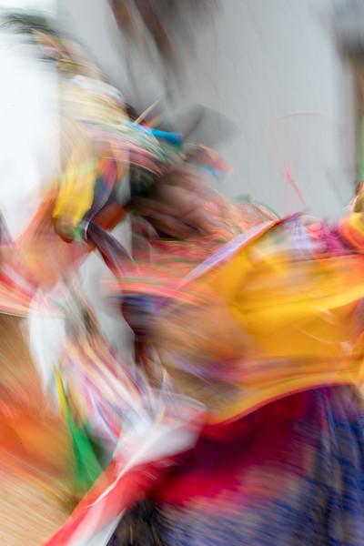 Kurjey Tshechu, Bumthang, Bhutan. A black hat dancer paints an abstract.
