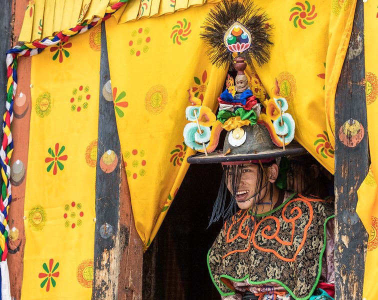 "Nimalung Tshechu, Bumthang, Bhutan. This black hat dancer is entering the courtyard from ""backstage"" in the monastery."