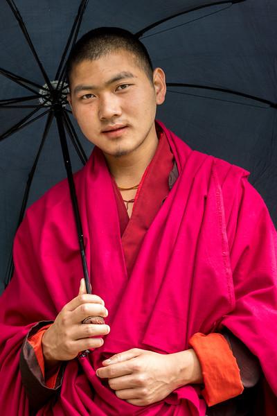 Phobjikha Valley, Bhutan. A young monk on a village road.
