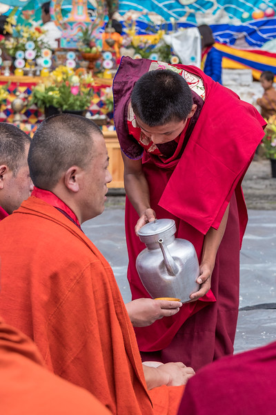 Kurjey Tshechu, Bumthang, Bhutan.  As part of the ceremonies, monks are served food and drink.