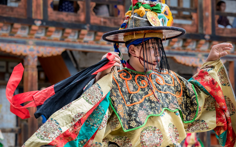 Nimalung Tshechu, Bumthang, Bhutan. In the Dance of the Black Hats with Ritual Daggers (Shanag Phur), the dagger in the right hand of a dancer - a symbol of transcendental wisdom - is used to overthrow demons and purify and protect the place.