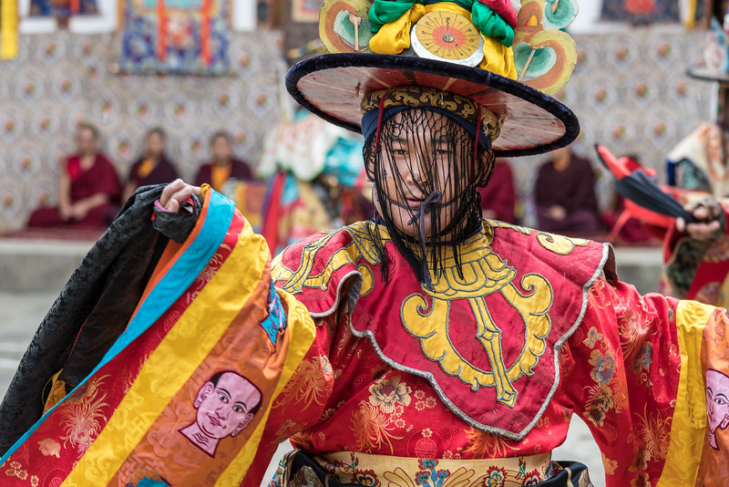Nimalung Tshechu, Bumthang, Bhutan. The black hat dance also represents the story of the assasination of an anti-Buddhist Tibetan king by a monk who had hidden his bow and arrows within the voluminous sleeves of his garment.