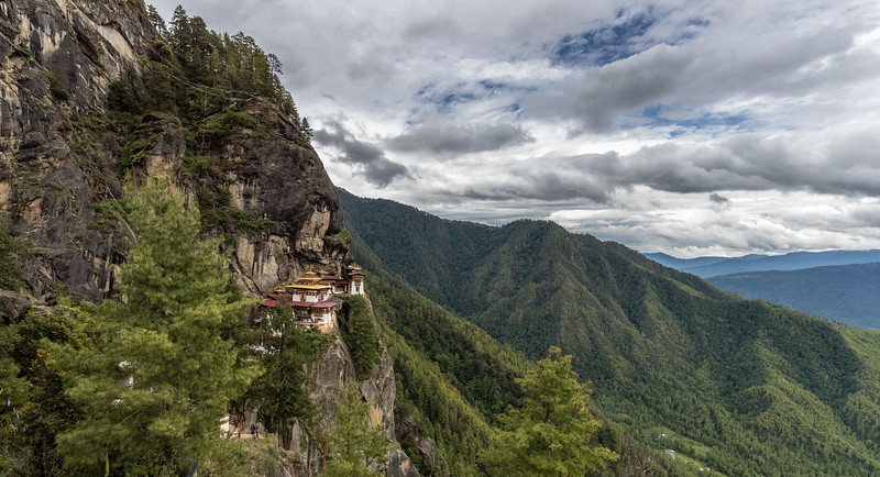 Taktsang, Bhutan. The monastery's altitude is about 3100m (over 10,170 feet), but this part of the access trail is higher and provides an expansive view of the monastery and its mountainous environs. The trail to the monastery includes the stairs that are visible in the lower left of the image.