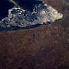 Astronaut Tom Jones: Lake Erie Ice Flow, April 15, 1994. Looking at early spring from shuttle Endeavour with my crew on STS-59, Space Radar Lab 1. <br /> <br /> NASA: Ice flows are visible along the eastern shore of Lake Erie in this north-looking view. Lake Erie is 241 miles (388 km) long and from 30 to 57 miles (48 to 92 km) wide. Lake Erie is the fourth largest and shallowest of the five Great lakes with a maximum depth of 210 feet (64 meters), and is the only Great Lake with its lake floor above sea level. Lake Erie is partially ice bound in winter and is normally closed to ship traffic from mid-December to the end of March. As the ice begins to break up in March, predominantly westerly winds push the ice eastward toward Buffalo, New York (top right of image). The city of Erie, Pennsylvania can be seen near the left center of the image on the southern shore of Lake Erie. Presque Isle, a peninsula, is discernible protruding out into Lake Erie. This peninsula helps form Erie's superb harbor, Pennsylvania's only Great Lakes port. Portions of the dissected Allegheny Plateau can be seen covering the lower right quadrant of the image. Near the center of the image, the bluish-colored waters of Chautauqua Lake are discernible. To the south of Chautauqua Lake are sediment-laden waters of the Allegheny Reservoir.